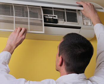 Man Cleaning Air Condition